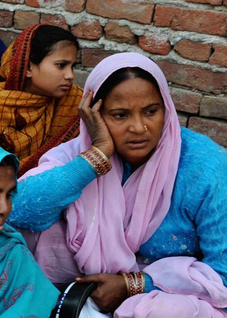Women who lost their houses in a fire that broke out in North Delhi's Bhalswa on Nov 23, 2015.