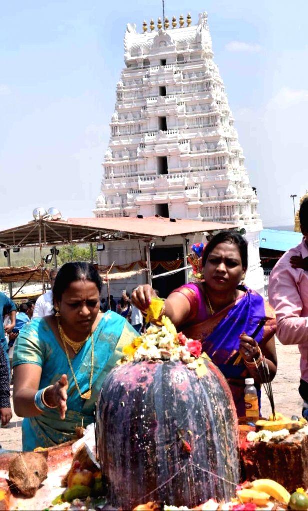 Women worship Lord Shiva on Maha Shivratri at Keesaragutta Temple in Medchal-Malkajgiri district of Telangana on March 4, 2019.