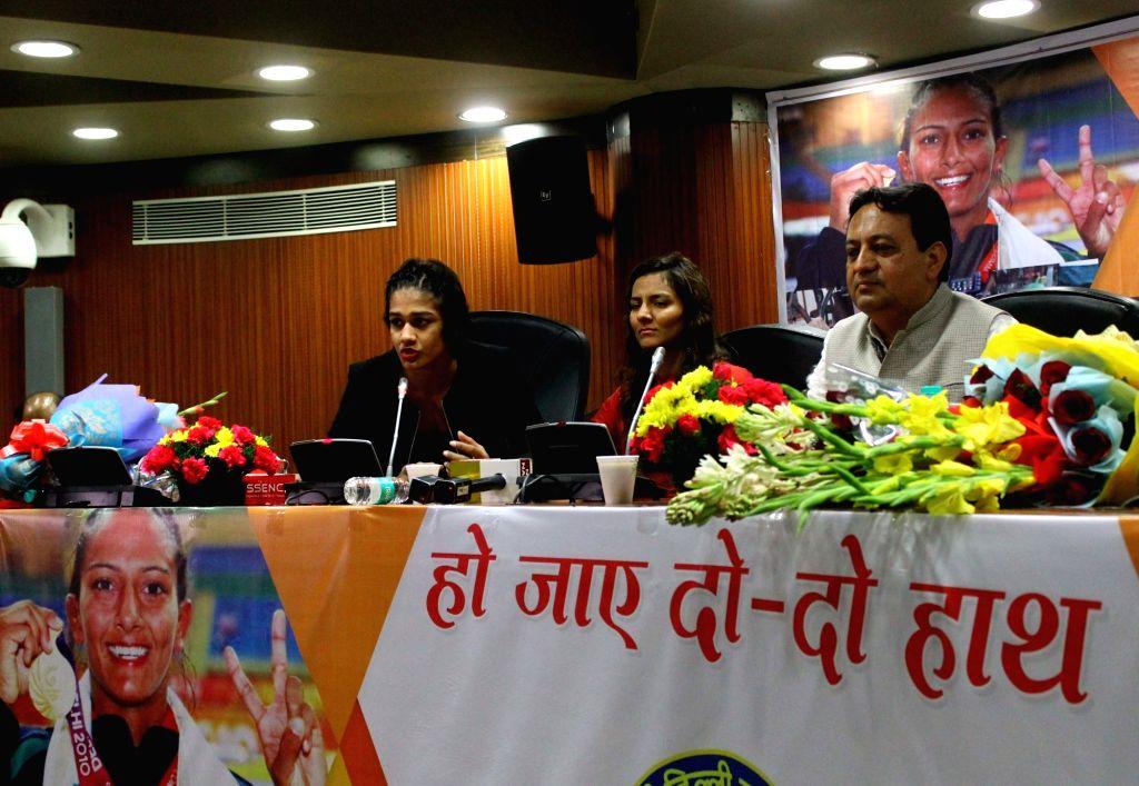 Women wrestlers Geeta and Babita Phogat during a SDMC programme in New Delhi on March 2, 2017.
