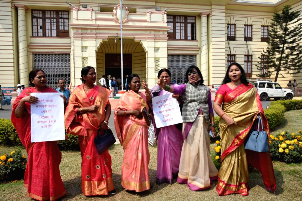Womens MLA raise slogans to press for their various demands to the mark of International Women's Day at Bihar Assembly, in Patna on Monday Mar 08, 2021  .
