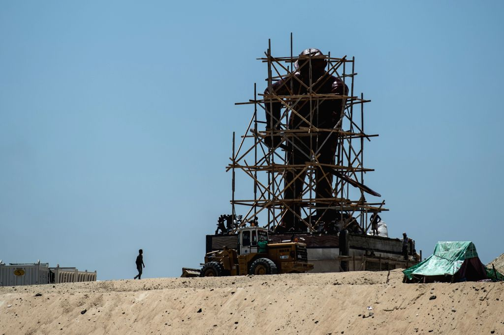 """Workers are seen on the construction site of the new Suez Canal in Ismailia, a port city in Egypt, on July 29, 2015. The dredging work of Egypt's """"New Suez ..."""