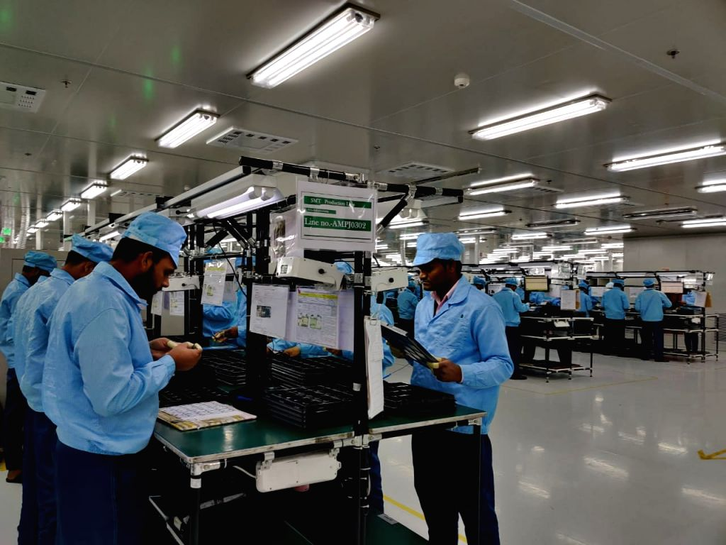 Workers at the OPPO Manufacturing unit in Greater Noida.