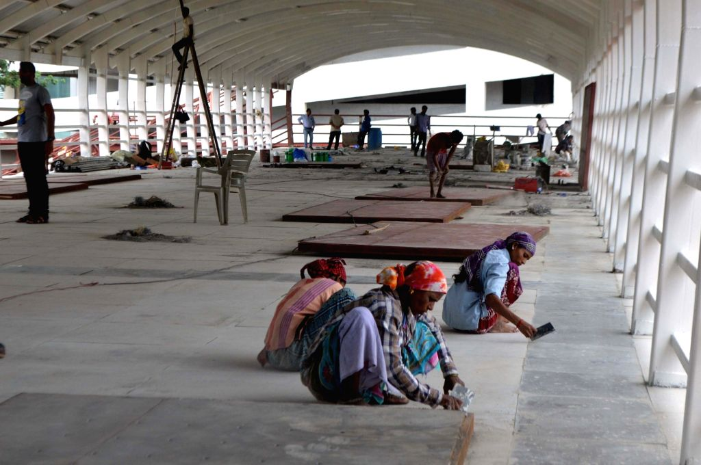 Workers busy giving finishes touches to the footover bridge at Elphinstone railway station which is expected to be thrown open to the public soon, in Mumbai on July 1, 2018.