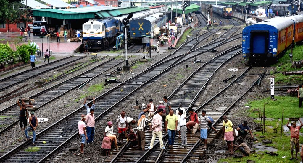 Workers busy in ongoing repair works on railway tracks in Guwahati on June 2, 2017.