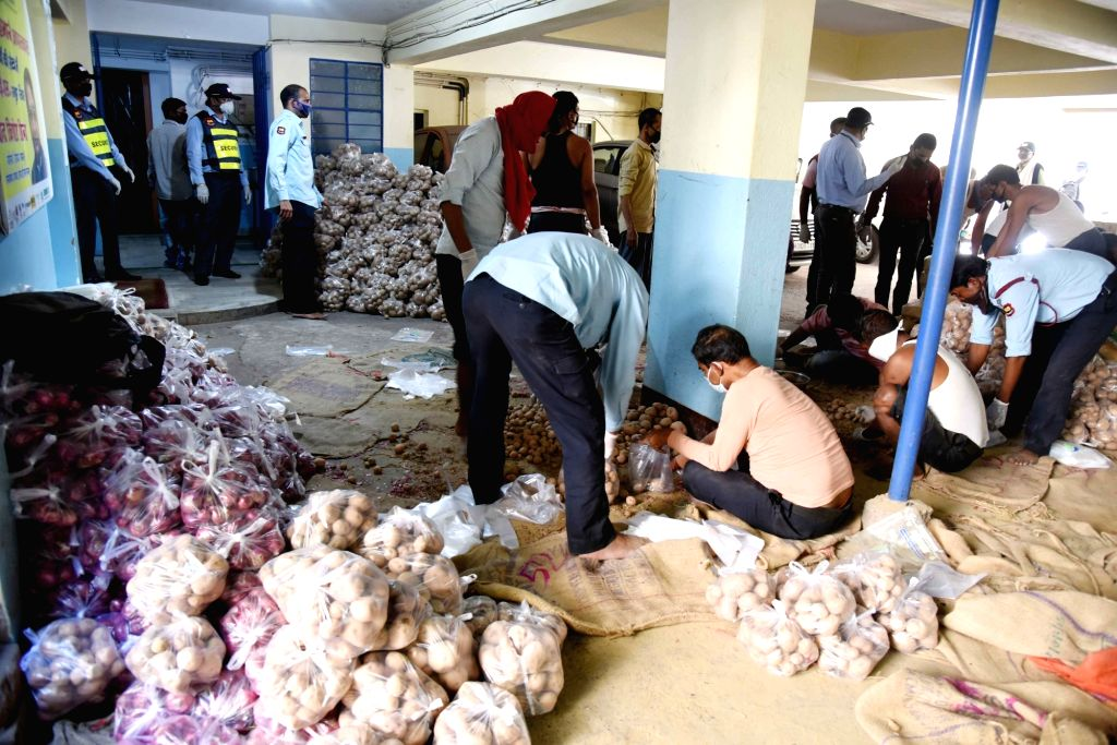 Workers busy preparing packages of essential commodities to be supplied to the people on Day 4 of the lockdown imposed in the wake of the coronavirus pandemic, in Patna on March 28, 2020.