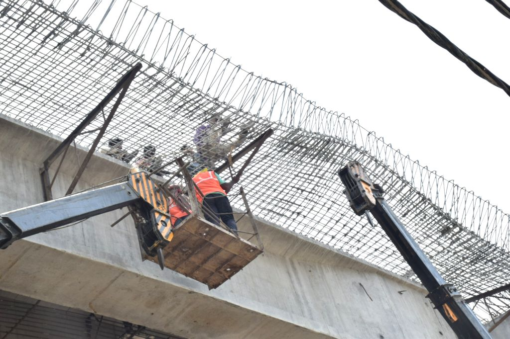 Workers busy working at the flyover - a part of the shuttering of which fell on the road below in Varanasi on June 1, 2018. No one was injured as there was no traffic passing. The incident ...