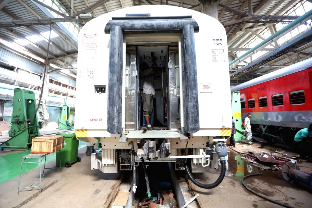 Workers busy working on the under-construction rail coaches at Integral Coach Factory in Chennai on July 4, 2017.