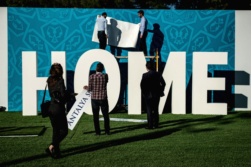 ": Workers decorate the ""Home Culture"" Zone of the site of G20 Summit, which will be held from Nov. 15 to 16, in Antalya, a Mediterranean resort city of Turkey, on ..."