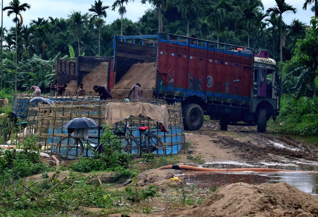 Workers engaged in sand mining on the river beds of Singra River in Assam's Kamrup on July 27, 2019. The Supreme Court on Wednesday issued notice to the Centre and others on a public suit ...