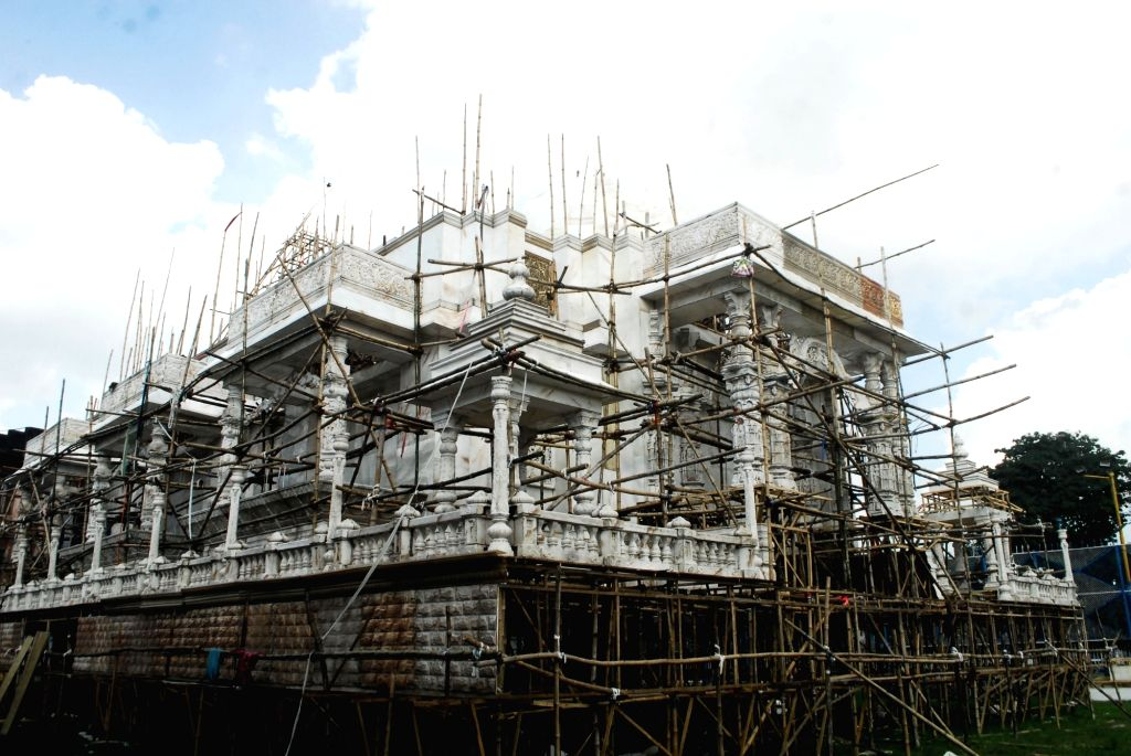 Workers giving finishing touch on Community puja pandal ahead  of Durga Puja festival  in Kolkata on Saturday October 02,2021.