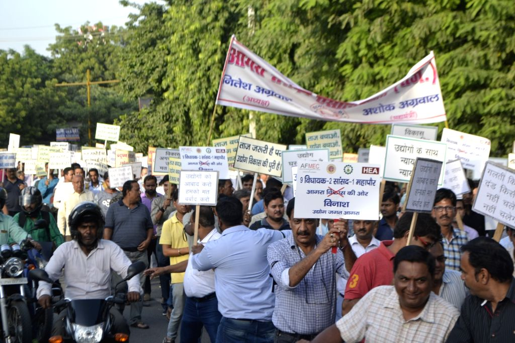 Workers, industrialists and social activists carrying placards and banners protest against the restrictions on industries in the eco-sensitive Taj Trapezium Zone spread over 10,400 sq.km.; in ...