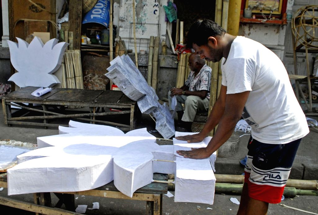 Workers making a political symbols ahead of State Assembly election in Kolkata on Saturday March 27, 2021.