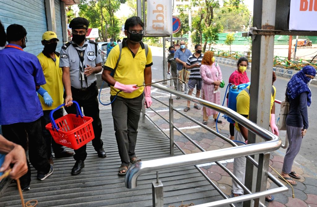 Workers of Bidhannagar Municipal Corporation spray disinfectants at Salt Lake on Day 2 of the 21-day nationwide lockdown imposed by the Narendra Modi government over the coronavirus ... - Narendra Modi