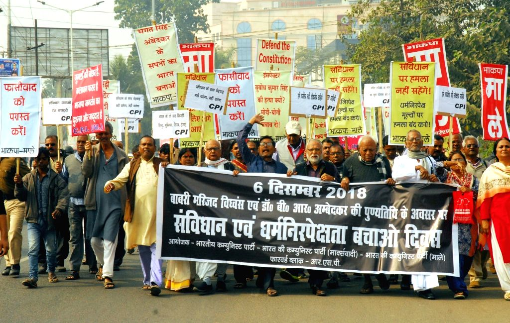 Workers of Communist parties participate in a demonstration organised on the death anniversary of Dalit icon B. R. Ambedkar and 26th anniversary of the Babri Masjid demolition in Patna on Dec ...