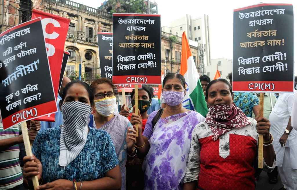 Workers of Congress and Left parties led by Left front Chairman Biman Bose and Congress leader Abdul Mannan, protest against the alleged gang rape and murder of a 19-year-old Dalit girl in ... - Biman Bose