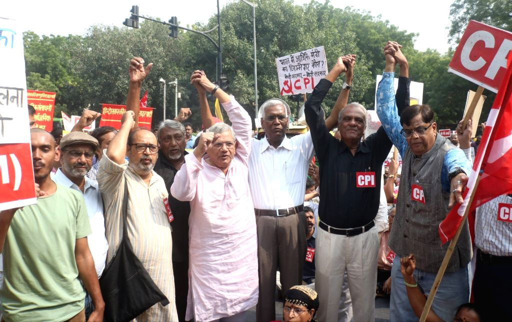 Workers of CPI and CPI-M and Members of All India Forward Bloc (AIFB) led by CPI General Secretary D. Raja and CPI-M General Secretary Sitaram Yehchury, participate in a protest rally ...