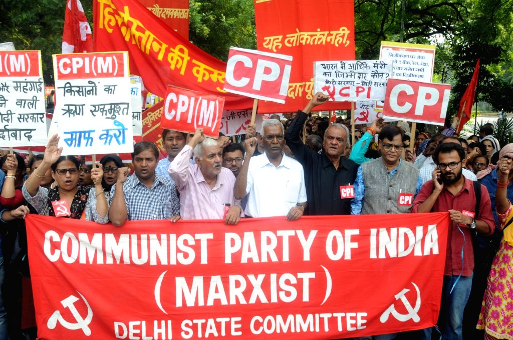 Workers of CPI and CPI-M and Members of All India Forward Bloc (AIFB) led by CPI General Secretary D. Raja, participate in a protest rally organised on 'deepening economic crisis and ...
