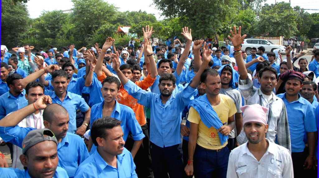 Workers of Hero MotoCorp stage a demonstration to press for their various demands in Gurgaon on Aug 12, 2014.