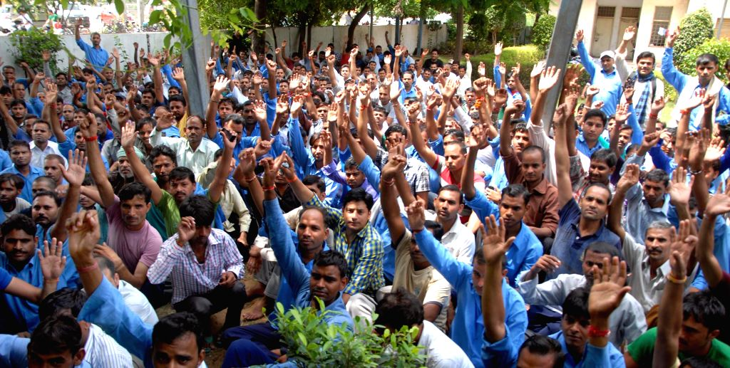 Workers of Hero MotoCorp stage a demonstration to press for their various demands in Gurgaon on Aug 13, 2014.