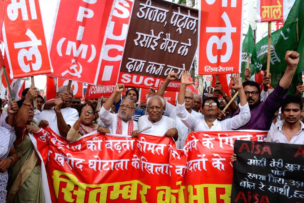 Workers of Left parties stage a demonstration during a nationwide shutdown protest or 'Bharat Bandh' against rising fuel prices called by opposition parties led by Congress, in Patna on Sept ...