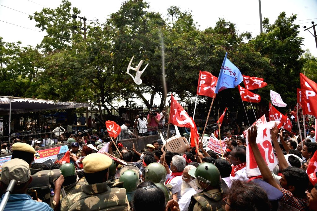 Workers of Left parties stage a protest over the shifting of 'Dharna Chowk', a popular venue for staging protests in Hyderabad on May 15, 2017.