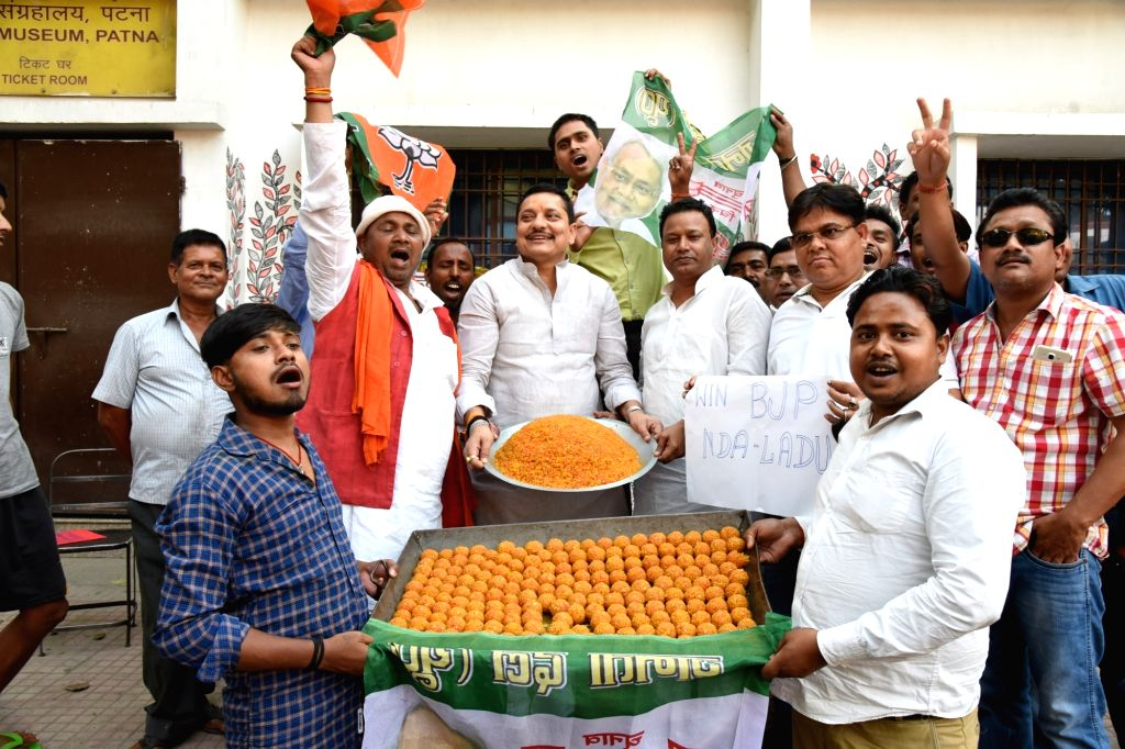 Workers of NDA parties celebrate with laddus -sweets- after most exit polls showed the BJP-led NDA getting a comfortable majority in the recently concluded 2019 Lok Sabha elections, in Patna ...