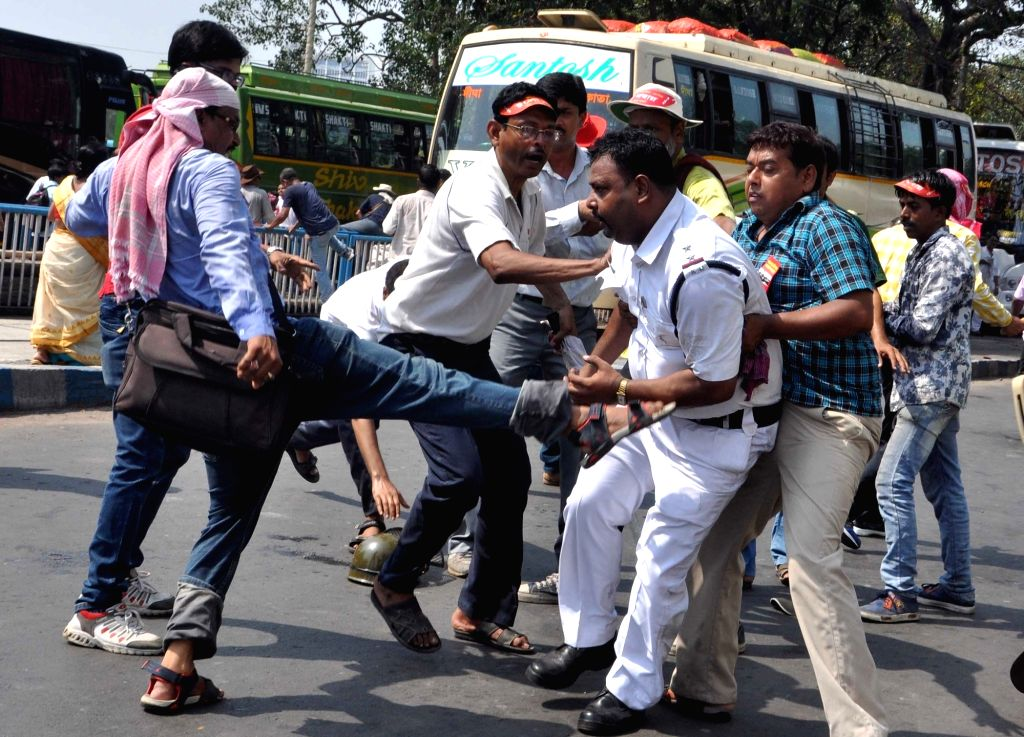 Workers of parties affiliated to the Left Front clash with police after a number of Left Front MLAs including its legislature party leader Sujan Chakraborty were detained from outside the ... - Sujan Chakraborty