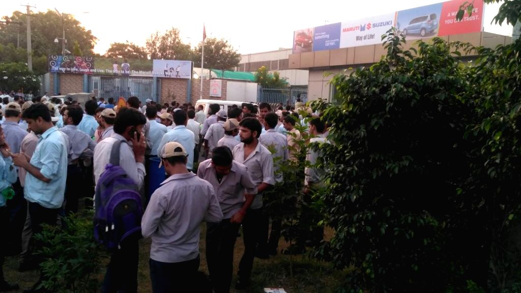 Workers outside Suzuki Manesar plant after leopard entered the factory.