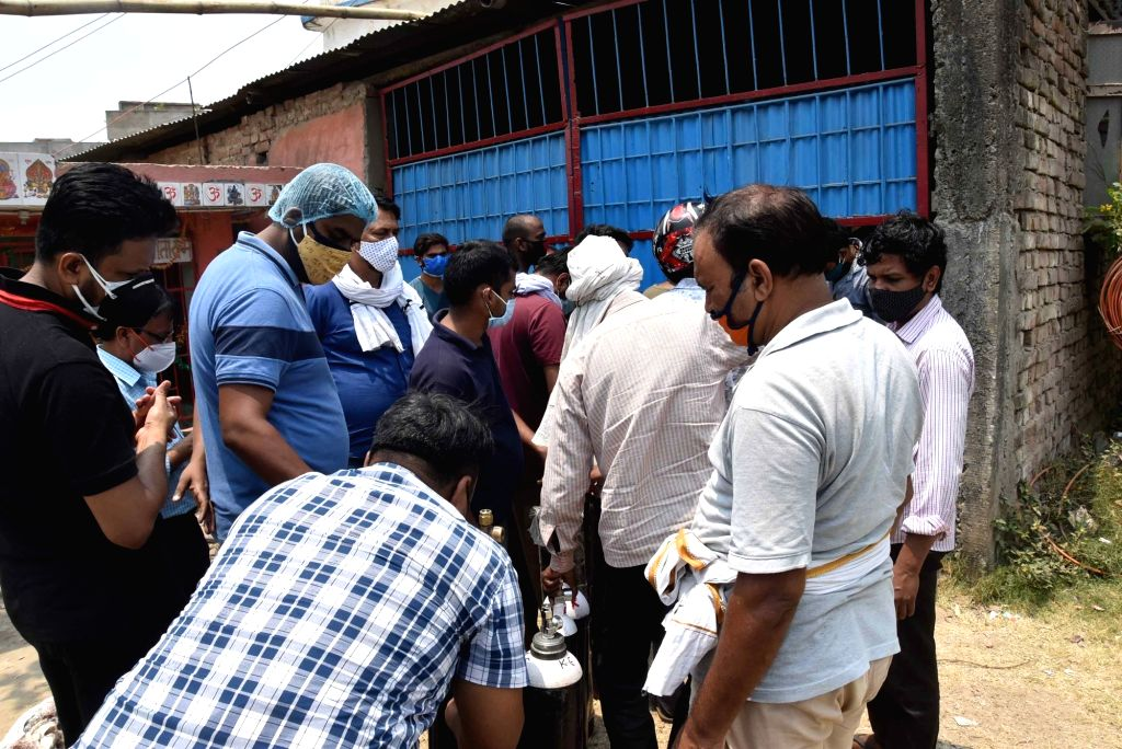 Workers refill oxygen cylinders for hospitals treating Covid-19 patients, amid the rise in Covid-19 cases across the country, in Patna On Tuesday, May 04, 2021.