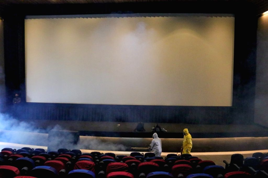 Workers sanitize a hall of a movie theater in Mexico City, Mexico, Aug. 12, 2020. Some movie theaters in Mexico City have reopened to the public with epidemic ...