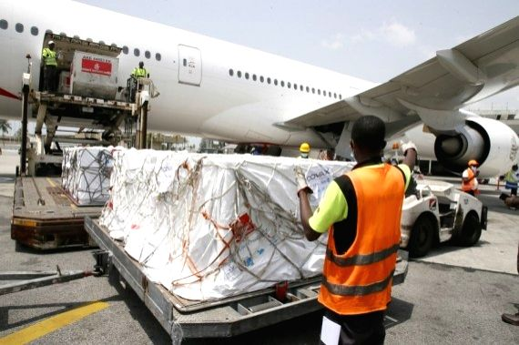 Workers transfer boxes of COVID-19 vaccines arrived at Abidjan International Airport in Abidjan, Cote d'Ivoire, Feb. 26, 2021.