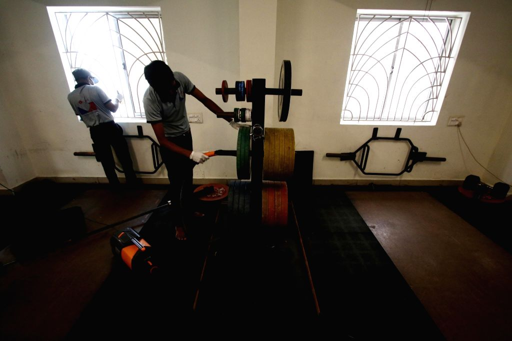 Workout equipments being sanitised at a gym as it gears up to reopen for people amid COVID-19 pandemic as part of Unlock 3.0, in Chennai on Aug 6, 2020.