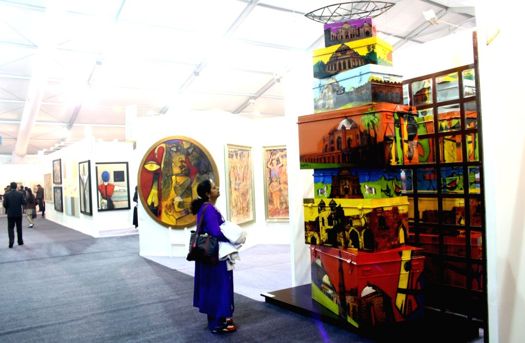 Works on display at the India Art Fair with a new installation by Paresh Maity in the foreground.