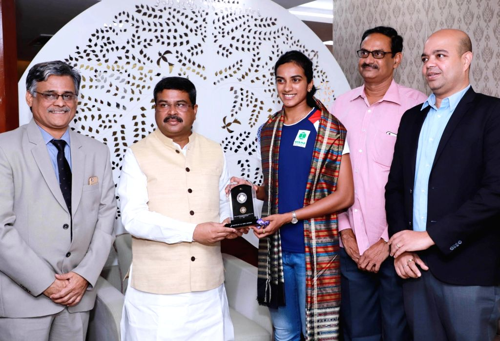 World Badminton Champion P.V. Sindhu calls on Union Petroleum and Natural Gas and Steel Minister Dharmendra Pradhan, in New Delhi on Sep 4, 2019. - Dharmendra Pradhan