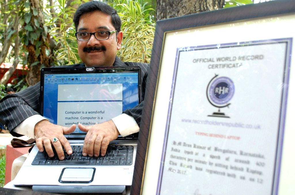 World Record holder H M Arun Kumar demonstrates his typing skills sitting behind a laptop with a speed of 400 characters per minute, during his press conference in Bengaluru on June 22, ...