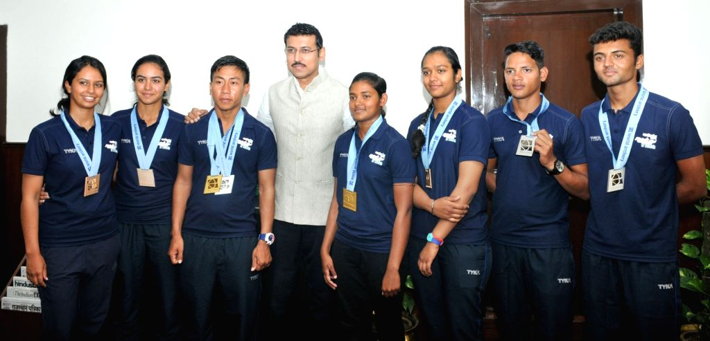 World Youth Archery Championship winners with Union Sports Minister Rajyavardhan Singh Rathore in New Delhi on Oct 12, 2017. - Rajyavardhan Singh Rathore