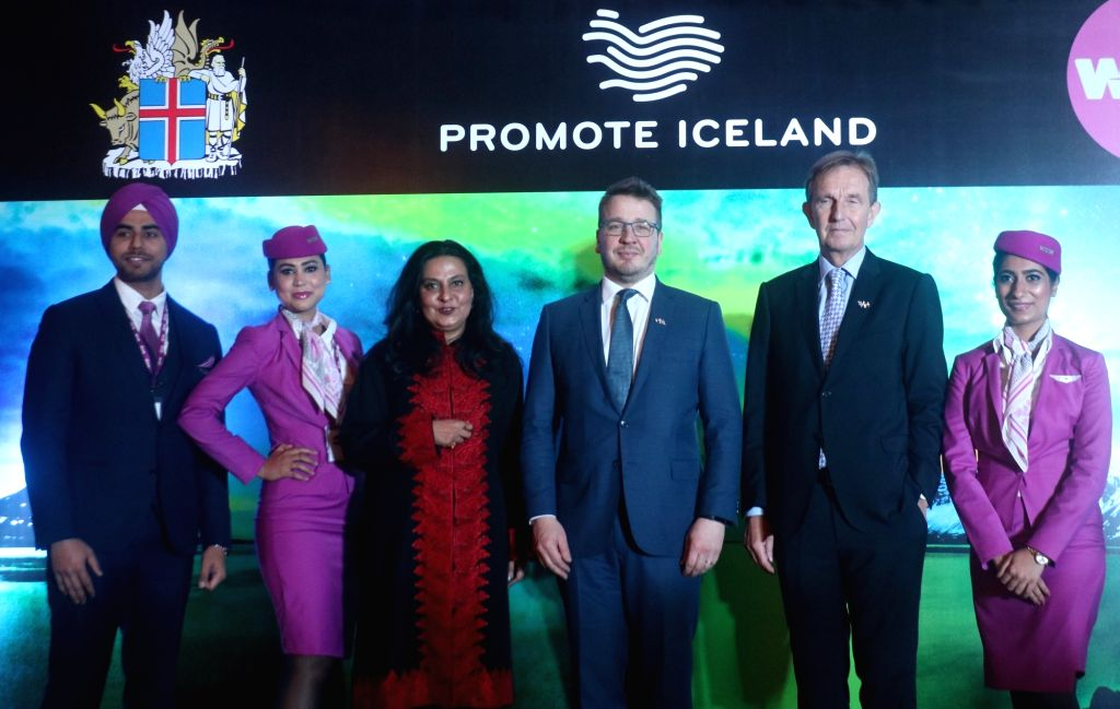 WOW air MD Kiran Jain, Iceland's Foreign Minister Gudlaugur Thor Thordarson and Iceland's Ambassador to India Gudmundur Arni Stefansson with the the airline's crew at a press conference ... - Gudlaugur Thor Thordarson and Kiran Jain