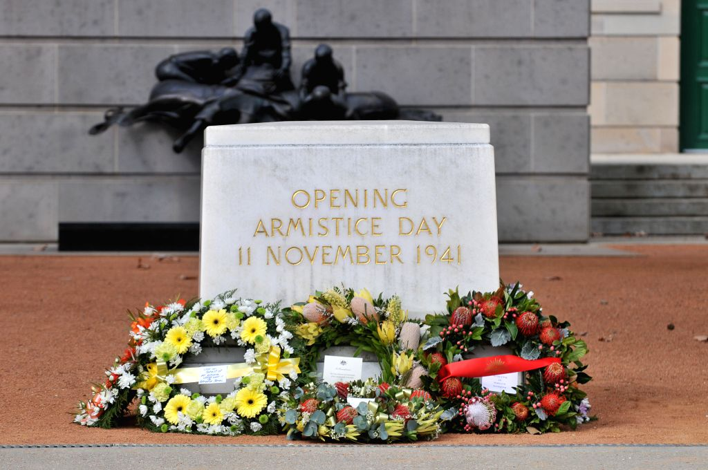Wreaths are laid around the memorial stone at the victory in the Pacific 70th anniversary commemoration service at the Australian War Memorial in Canberra, ...