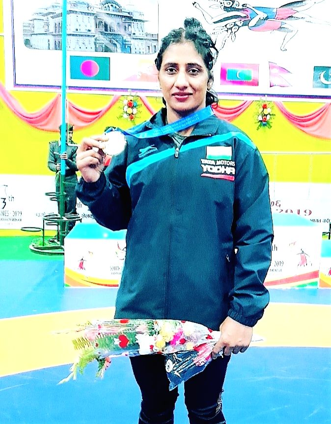 Wrestler Gurshanpreet Kaur after clinching a Gold medal after defeating her opponent at the 13th South Asian Games in Kathmandu, Nepal on Dec 7, 2019. - Gurshanpreet Kaur
