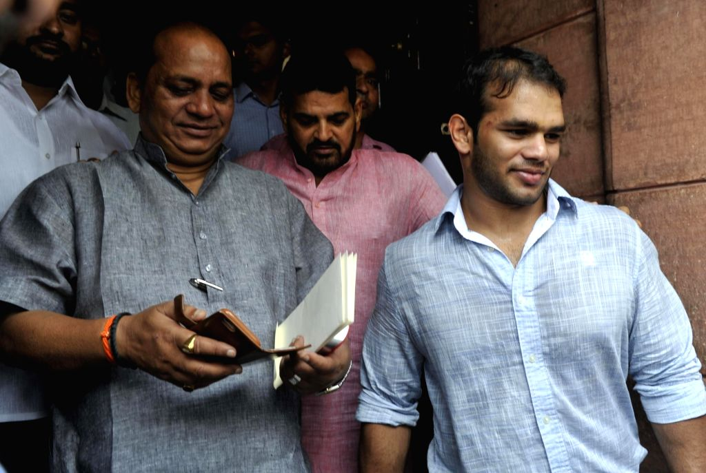 Wrestler Narsingh Yadav who has been given a clean chit in doping case by NADA at the Parliament in New Delhi on Aug 2, 2016. - Narsingh Yadav