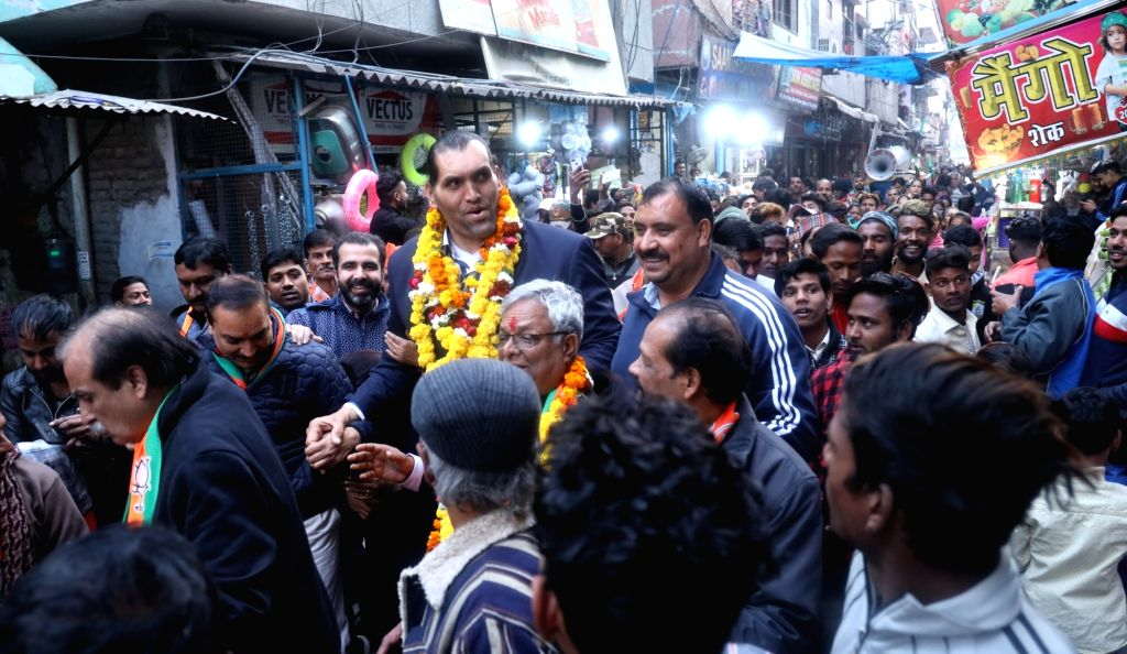 Wrestler the Great Khali campaigns for the BJP at Delhi's Majnu Ka Tila ahead of February 8 Delhi Assembly elections, in New Delhi on Feb 5, 2020.