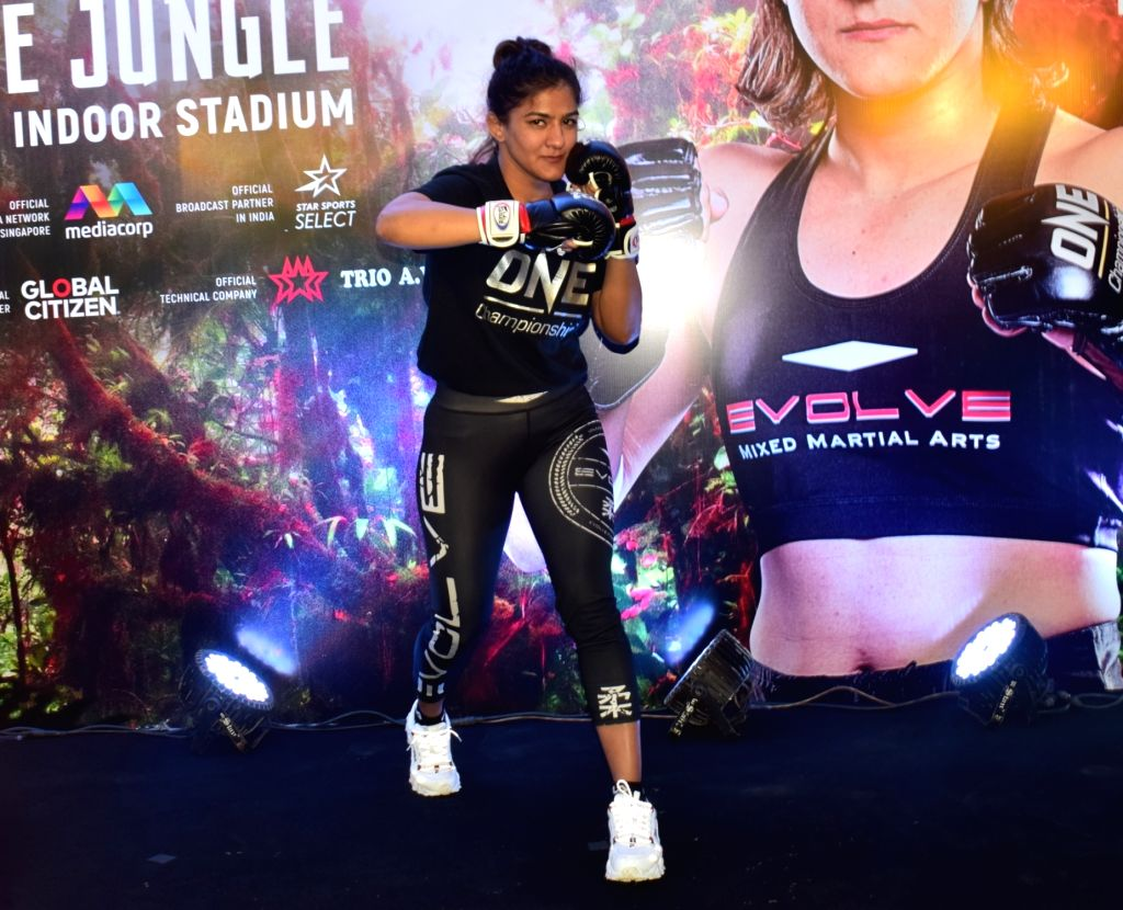 Wrestler-turned-Mixed Martial Arts fighter Ritu Phogat during her first open workout session ahead of her face-off with Chinese Taipei's Wu Chiao Chen on February 28 at the One: King of ...