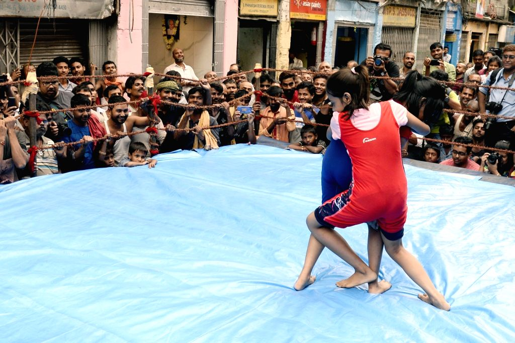 Wrestlers participate in a wrestling competition organised on the occasion of Kali Puja and Diwali, at Burabazaar in Kolkata on Oct 26, 2019.