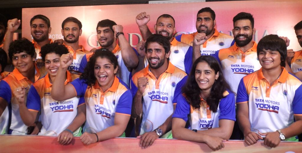 Wrestling Federation of India (WFI) President Brij Bhushan Saran with the Indian wrestlers during a sending off ceremony organised for them ahead of the 18th Asian Games scheduled to be ...