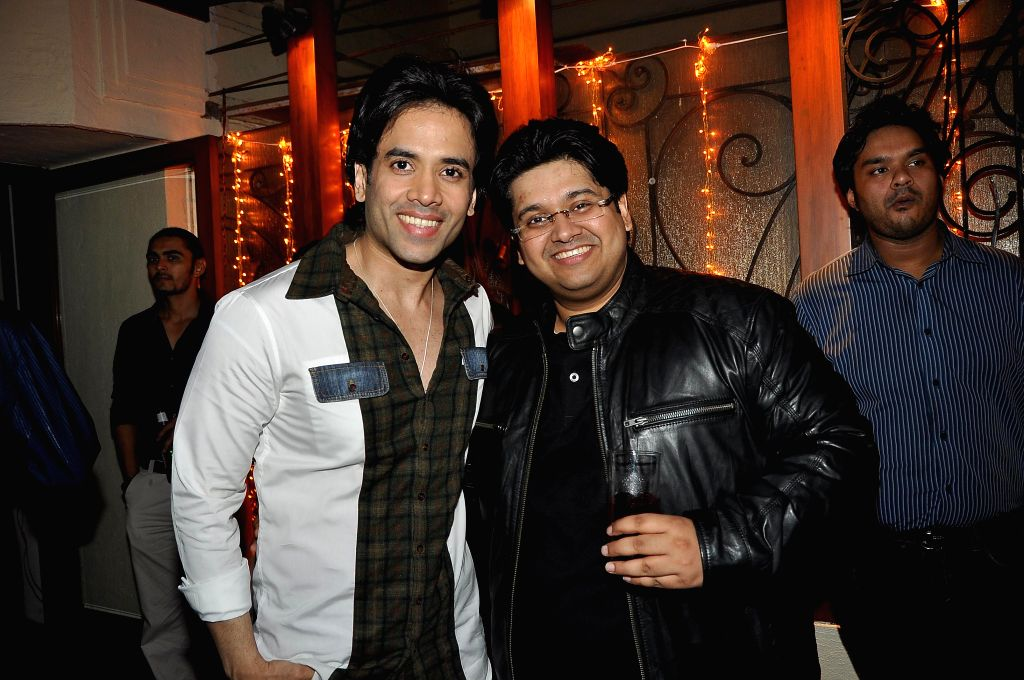 Writer Milap Zaveri with actor Tusshar Kapoor during a success party hosted by Sanjay Gupta to celebrate the success of the films 'Main Tera Hero', 'Grand Masti' and 'Shootout At Wadala' in Mumbai. - Tusshar Kapoor and Sanjay Gupta
