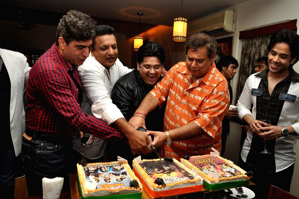 Writer Milap Zaveri with actor Tusshar Kapoor and filmmaker David Dhavan during a success party hosted by Sanjay Gupta to celebrate the success of the films 'Main Tera Hero', 'Grand Masti' and ... - Tusshar Kapoor and Sanjay Gupta