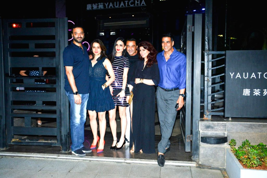 Writer-producer Twinkle Khanna, actor Bobby Deol along with his wife Tanya Deol during actor Akshay Kumar's birthday celebration in Mumbai on Sept 9, 2018. - Bobby Deol, Khanna and Akshay Kumar
