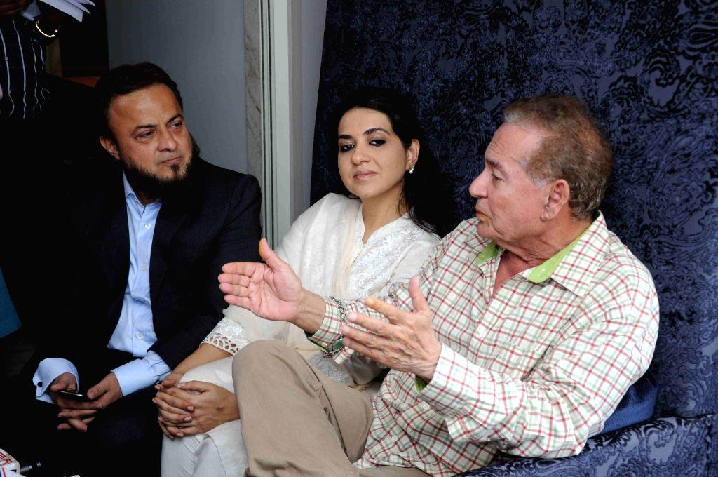 Writer Salim Khan launches Narendra Modi`s Urdu website at his residence in Bandra, Mumbai.