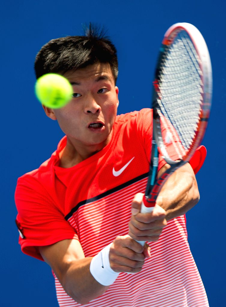 Wu Di of China returns the ball during the first-round match of men's singles of Australian Open Tennis Championships against Austin Krajicek of the United States ...