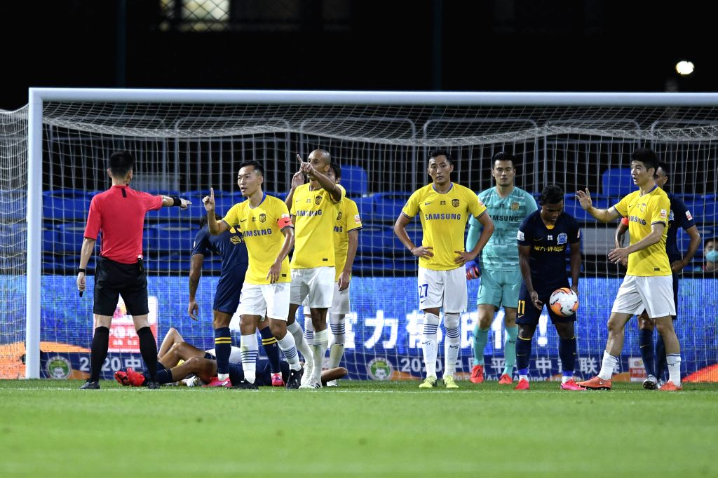 Wu Xi (2nd L, front) of Jiangsu Suning talks with referee during the fourth round match between Guangzhou R&F and Jiangsu Suning at the postponed 2020 season ...